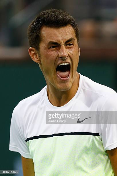 Bernard Tomic of Australia celebrates defeating Thanasi Kokkinakis of Australia during day ten of the BNP Paribas Open tennis at the Indian Wells...