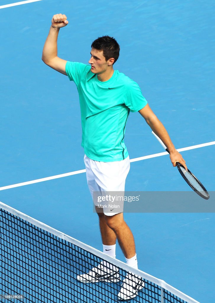 <a gi-track='captionPersonalityLinkClicked' href=/galleries/search?phrase=Bernard+Tomic&family=editorial&specificpeople=650713 ng-click='$event.stopPropagation()'>Bernard Tomic</a> of Australia celebrates his win in his second round match over Florian Meyer of Germany during day four of the Sydney International at Sydney Olympic Park Tennis Centre on January 9, 2013 in Sydney, Australia.