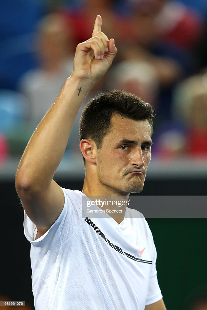 Bernard Tomic of Australia celebrates winning his second round match against Victor Estrella Burgos of The Dominican Republic on day three of the 2017 Australian Open at Melbourne Park on January 18, 2017 in Melbourne, Australia.