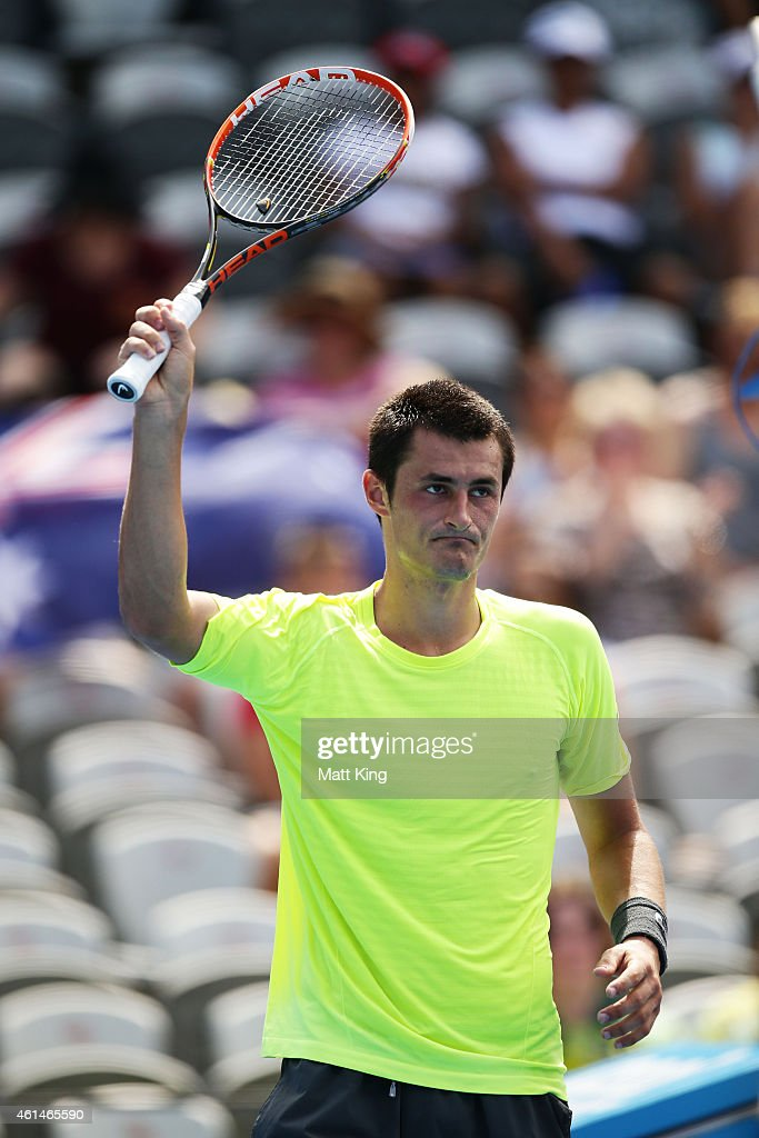 Bernard Tomic of Australia celebrates winning match point in his match against Igor Sijsling of the Netherlands during day three of the Sydney International at Sydney Olympic Park Tennis Centre on January 13, 2015 in Sydney, Australia.