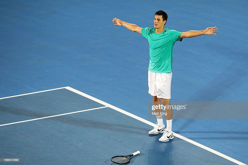 <a gi-track='captionPersonalityLinkClicked' href=/galleries/search?phrase=Bernard+Tomic&family=editorial&specificpeople=650713 ng-click='$event.stopPropagation()'>Bernard Tomic</a> of Australia celebrates winning match point in the men's final match against Kevin Anderson of South Africa during day seven of the Sydney International at Sydney Olympic Park Tennis Centre on January 12, 2013 in Sydney, Australia.