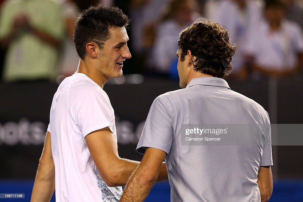 Bernard Tomic of Australia congratulates Roger Federer of Switzerland on winning their third round match during day six of the 2013 Australian Open at Melbourne Park on January 19, 2013 in Melbourne, Australia.