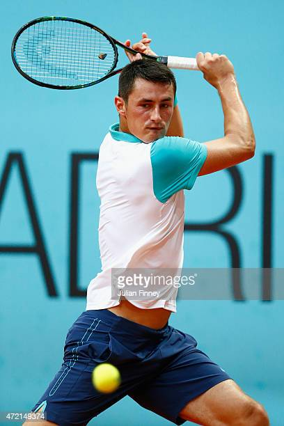 Bernard Tomic of Australia in action against Luca Vanni of Italy during day three of the Mutua Madrid Open tennis tournament at the Caja Magica on...