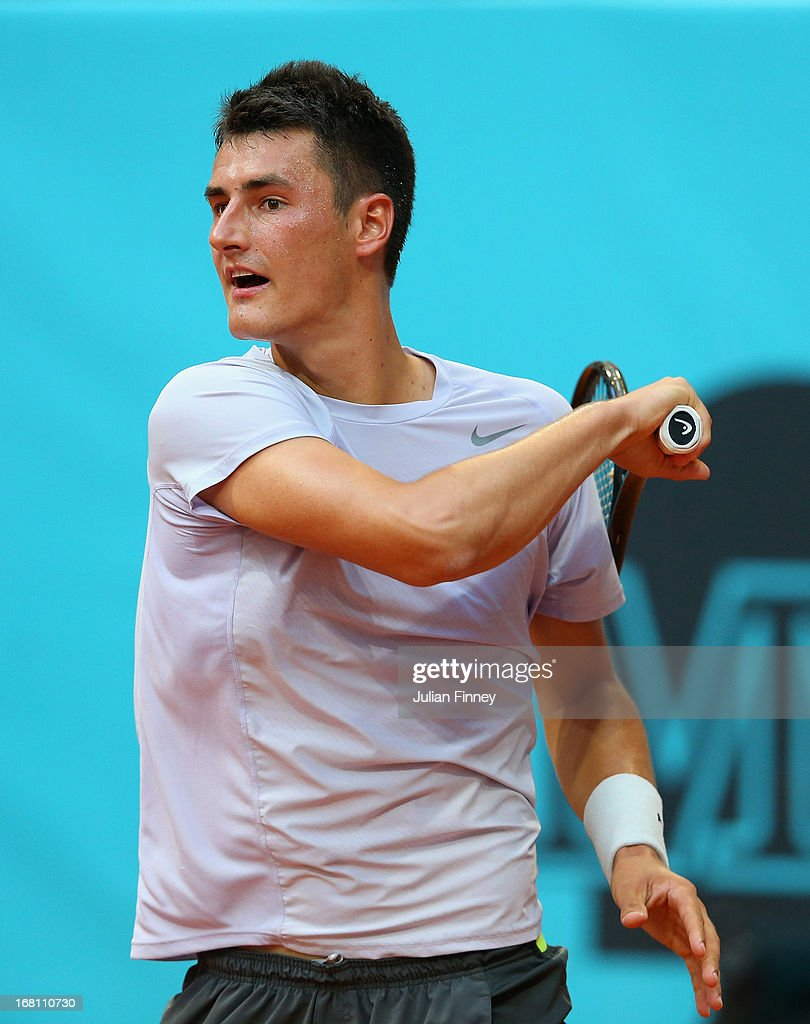 <a gi-track='captionPersonalityLinkClicked' href=/galleries/search?phrase=Bernard+Tomic&family=editorial&specificpeople=650713 ng-click='$event.stopPropagation()'>Bernard Tomic</a> of Australia in action against Radek Stepanek of Czech Republic during day two of the Mutua Madrid Open tennis tournament at the Caja Magica on May 5, 2013 in Madrid, Spain.
