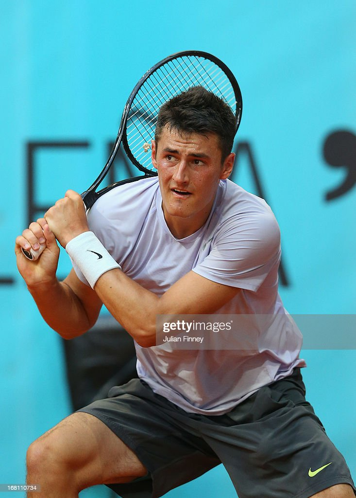 Bernard Tomic of Australia in action against Radek Stepanek of Czech Republic during day two of the Mutua Madrid Open tennis tournament at the Caja Magica on May 5, 2013 in Madrid, Spain.