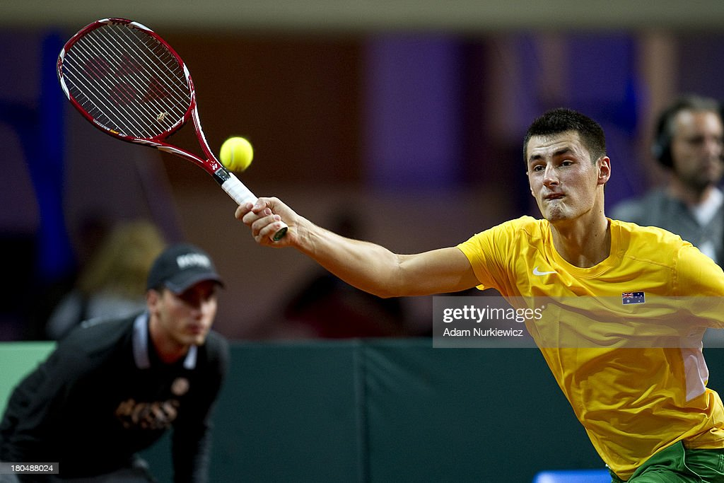 Bernard Tomic of Australia in action during the Davis Cup match between Poland and Australia at the Torwar Hall, on September 13, 2013 in Warsaw, England.