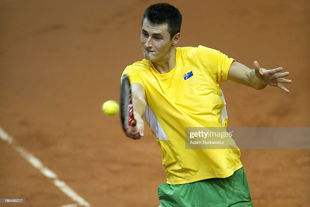 <a gi-track='captionPersonalityLinkClicked' href=/galleries/search?phrase=Bernard+Tomic&family=editorial&specificpeople=650713 ng-click='$event.stopPropagation()'>Bernard Tomic</a> of Australia in action during the Davis Cup match between Poland and Australia at the Torwar Hall, on September 13, 2013 in Warsaw, England.