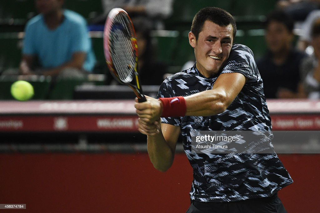 <a gi-track='captionPersonalityLinkClicked' href=/galleries/search?phrase=Bernard+Tomic&family=editorial&specificpeople=650713 ng-click='$event.stopPropagation()'>Bernard Tomic</a> of Australia in action during the men's singles first round match against Milos Raonic of Canada on day two of Rakuten Open 2014 at Ariake Colosseum on September 30, 2014 in Tokyo, Japan.