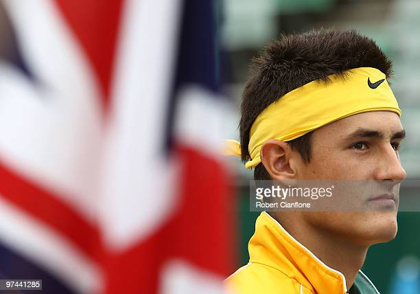 Bernard Tomic of Australia is seen during the nation anthem prior to his match against TsungHua Yang of Chinese Taipei during day of the Davis Cup...
