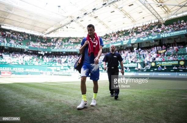 Bernard Tomic of Australia leaves the court after loosing his match against Richard Gasquet of France during Day 5 of the Gerry Weber Open 2017 at...