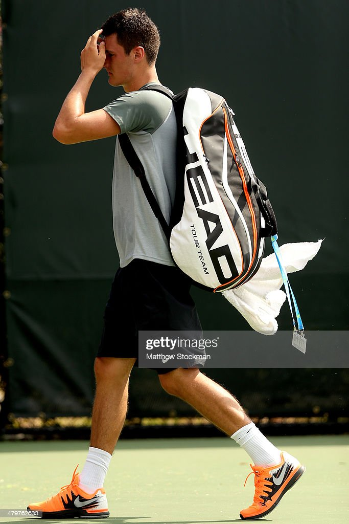 <a gi-track='captionPersonalityLinkClicked' href=/galleries/search?phrase=Bernard+Tomic&family=editorial&specificpeople=650713 ng-click='$event.stopPropagation()'>Bernard Tomic</a> of Australia leaves the court after losing to Jarkko Nieminen of Finland during the Sony Open at the Crandon Park Tennis Center on March 20, 2014 in Key Biscayne, Florida.