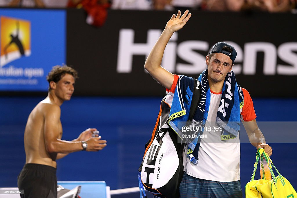<a gi-track='captionPersonalityLinkClicked' href=/galleries/search?phrase=Bernard+Tomic&family=editorial&specificpeople=650713 ng-click='$event.stopPropagation()'>Bernard Tomic</a> of Australia leaves the court as <a gi-track='captionPersonalityLinkClicked' href=/galleries/search?phrase=Rafael+Nadal&family=editorial&specificpeople=194996 ng-click='$event.stopPropagation()'>Rafael Nadal</a> of Spain claps, after Tomic retired from their first round match during day two of the 2014 Australian Open at Melbourne Park on January 14, 2014 in Melbourne, Australia.