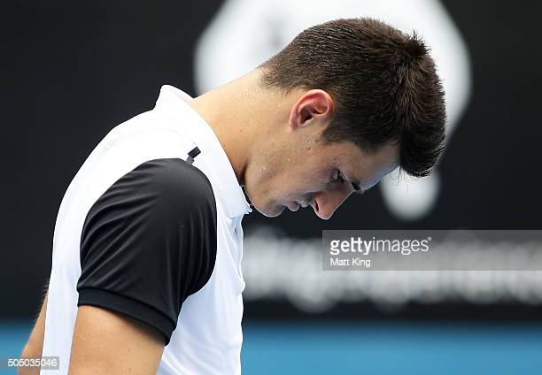 Bernard Tomic of Australia looks dejected as he forfeits his game against Teymuraz Gabashvili of Russia during day six of the 2016 Sydney...