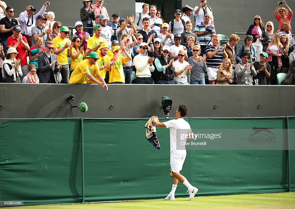 <a gi-track='captionPersonalityLinkClicked' href=/galleries/search?phrase=Bernard+Tomic&family=editorial&specificpeople=650713 ng-click='$event.stopPropagation()'>Bernard Tomic</a> of Australia passes his towel to the Australian Fanatics during the Men's Singles second round match against Radu Albot of Moldova on day four of the Wimbledon Lawn Tennis Championships at the All England Lawn Tennis and Croquet Club on June 30, 2016 in London, England.