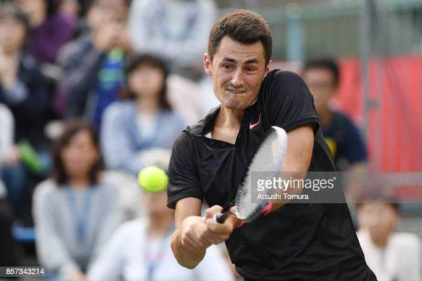 Bernard Tomic of Australia plays a backhand against Diego Schwartzman of Argentina during day three of the Rakuten Open at Ariake Coliseum on October...