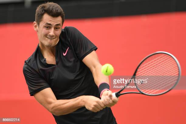 Bernard Tomic of Australia plays a backhand against Joao Sousa of Portugal during day one of the Rakuten Open at Ariake Coliseum on October 2 2017 in...