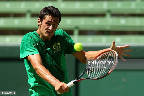 Bernard Tomic of Australia plays a backhand during a practice session ahead of the Davis Cup Tie between Australia and the United States at Kooyong...