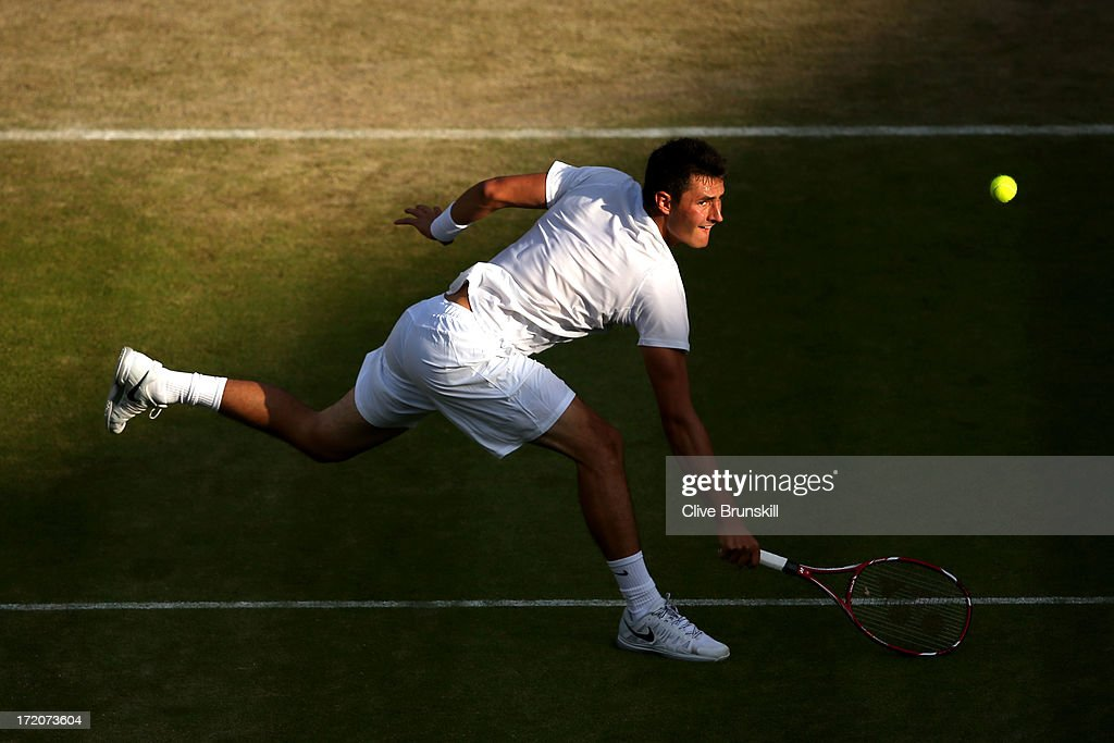 <a gi-track='captionPersonalityLinkClicked' href=/galleries/search?phrase=Bernard+Tomic&family=editorial&specificpeople=650713 ng-click='$event.stopPropagation()'>Bernard Tomic</a> of Australia plays a backhand during the Gentlemen's Singles fourth round match against Tomas Berdych of Czech Republic on day seven of the Wimbledon Lawn Tennis Championships at the All England Lawn Tennis and Croquet Club on July 1, 2013 in London, England.