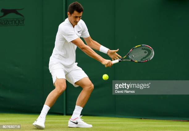 Bernard Tomic of Australia plays a backhand during the Gentlemen's Singles first round match against Mischa Zverev of Germany on day two of the...