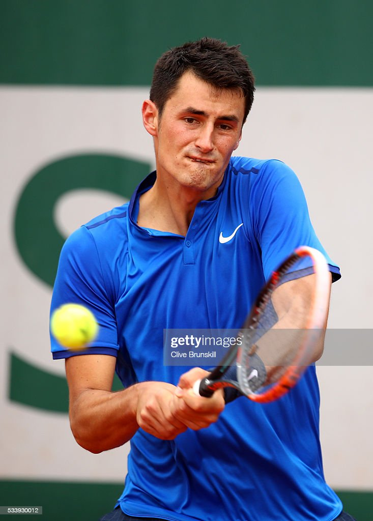 <a gi-track='captionPersonalityLinkClicked' href=/galleries/search?phrase=Bernard+Tomic&family=editorial&specificpeople=650713 ng-click='$event.stopPropagation()'>Bernard Tomic</a> of Australia plays a backhand during the Men's Singles first round match against Brian Baker of the United States on day three of the 2016 French Open at Roland Garros on May 24, 2016 in Paris, France.