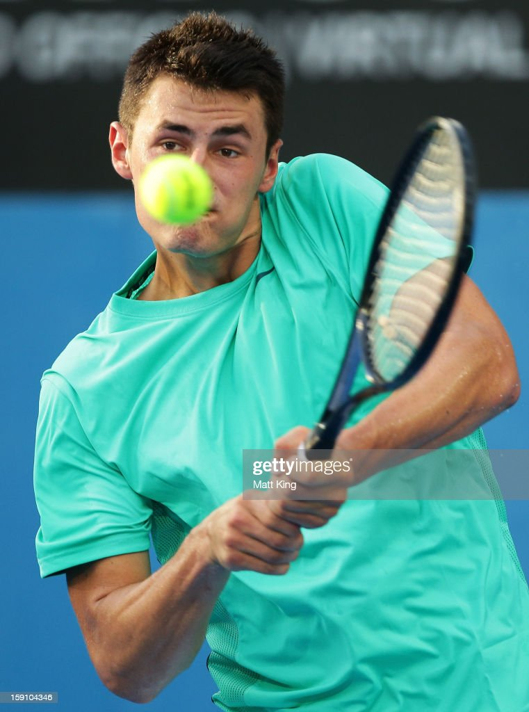 <a gi-track='captionPersonalityLinkClicked' href=/galleries/search?phrase=Bernard+Tomic&family=editorial&specificpeople=650713 ng-click='$event.stopPropagation()'>Bernard Tomic</a> of Australia plays a backhand in his first round match against Marinko Matosevic of Australia during day three of Sydney International at Sydney Olympic Park Tennis Centre on January 8, 2013 in Sydney, Australia.