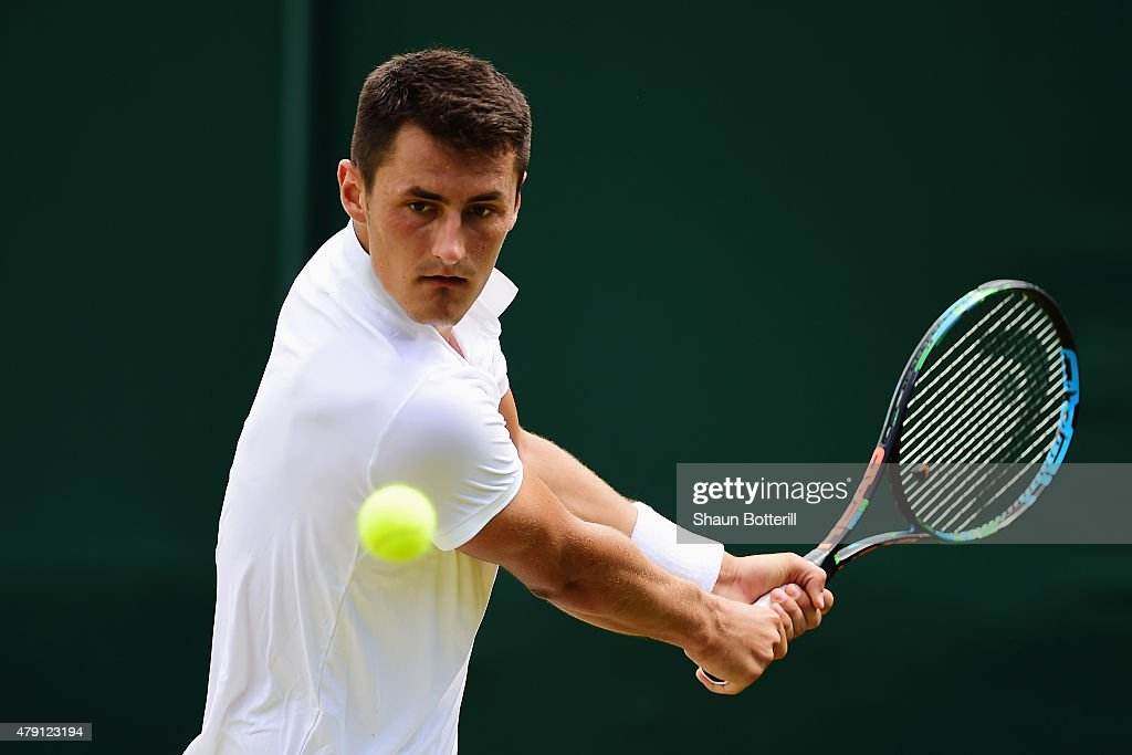 <a gi-track='captionPersonalityLinkClicked' href=/galleries/search?phrase=Bernard+Tomic&family=editorial&specificpeople=650713 ng-click='$event.stopPropagation()'>Bernard Tomic</a> of Australia plays a backhand in his Gentlemens Singles Second Round match against Pierre-Hugues Herbert of France during day three of the Wimbledon Lawn Tennis Championships at the All England Lawn Tennis and Croquet Club on July 1, 2015 in London, England.