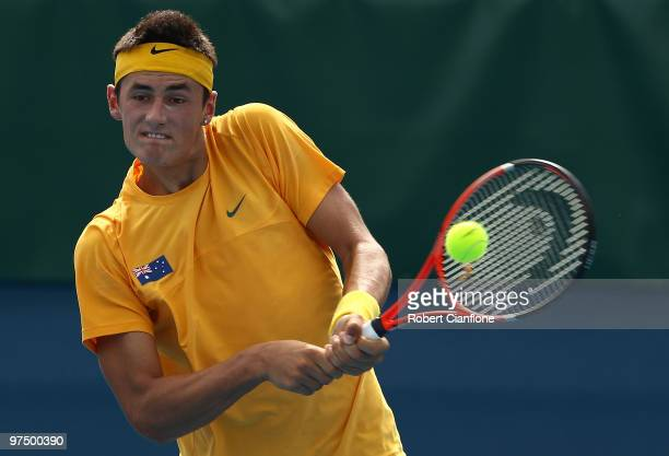 Bernard Tomic of Australia plays a backhand in his match against HsinHan Lee of Chinese Taipei during day three of the Davis Cup AsiaOceania Zone...