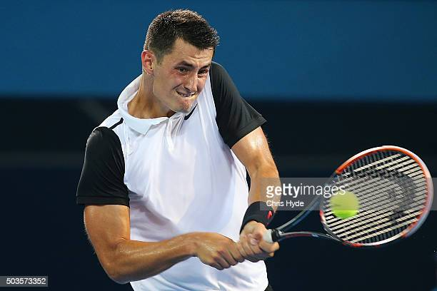 Bernard Tomic of Australia plays a backhand in his match against Radek Stepanek of the Czech Republic during day four of the 2016 Brisbane...