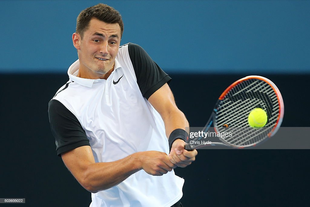Bernard Tomic of Australia plays a backhand in his quarter final matach against Kei Nishikori of Japan during day six of the 2016 Brisbane...