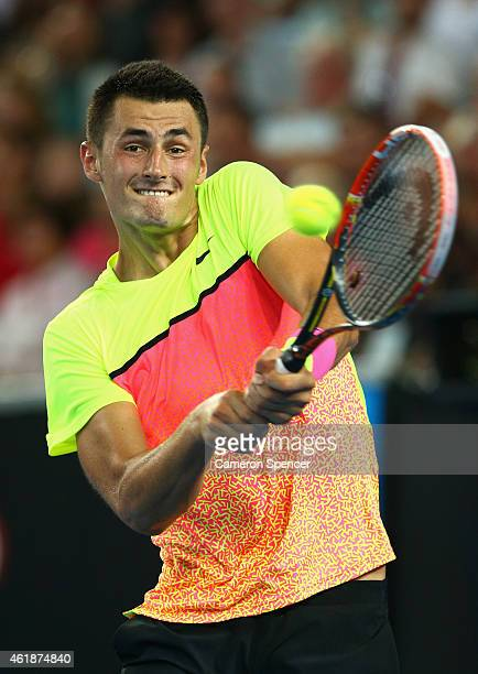 Bernard Tomic of Australia plays a backhand in his second round match against Philipp Kohlschreiber of Germany during day three of the 2015...