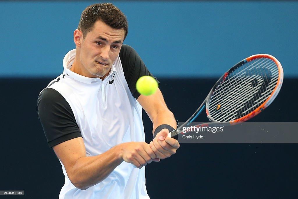 Bernard Tomic of Australia plays a backhand in his semi final match against Milos Raonic of Canada during day seven of the 2016 Brisbane...