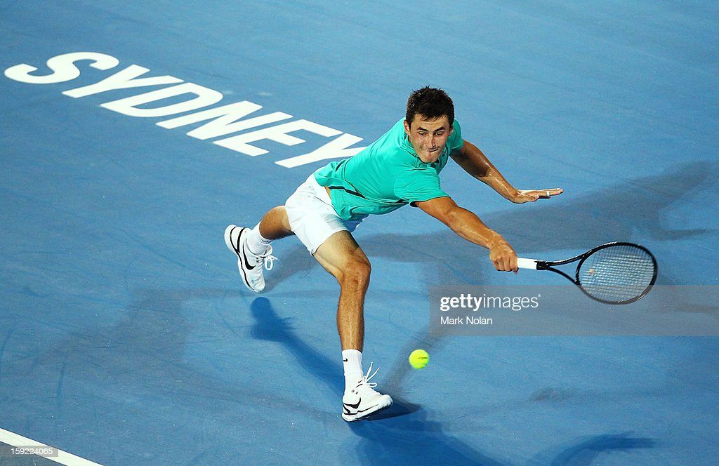 <a gi-track='captionPersonalityLinkClicked' href=/galleries/search?phrase=Bernard+Tomic&family=editorial&specificpeople=650713 ng-click='$event.stopPropagation()'>Bernard Tomic</a> of Australia plays a backhand in his semifinal match against Jarkko Nieminen of Finland during day five of the Sydney International at Sydney Olympic Park Tennis Centre on January 10, 2013 in Sydney, Australia.
