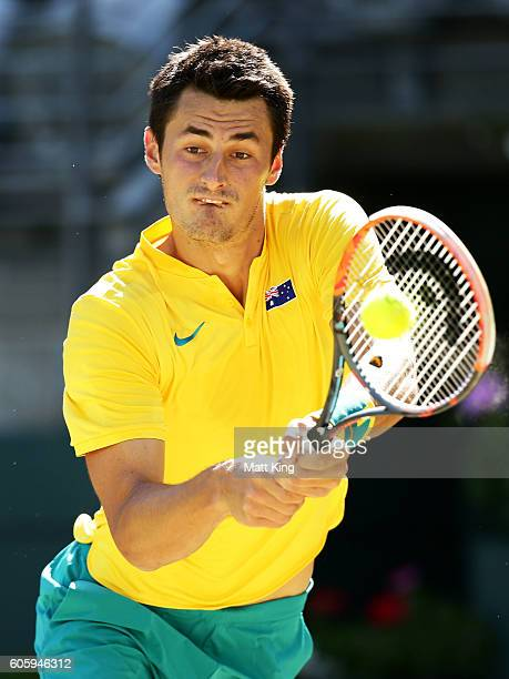 Bernard Tomic of Australia plays a backhand in his singles match against Jozef Kovalik of Slovakia during the Davis Cup World Group playoff between...