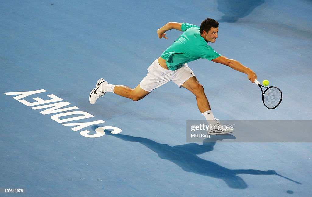 Bernard Tomic of Australia plays a backhand in the men's final match against Kevin Anderson of South Africa during day seven of the Sydney International at Sydney Olympic Park Tennis Centre on January 12, 2013 in Sydney, Australia.