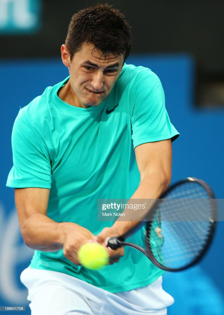Bernard Tomic of Australia plays a backhand in the Mens singles final against Kevin Anderson of South Africa during day seven of the Sydney International at Sydney Olympic Park Tennis Centre on January 12, 2013 in Sydney, Australia.