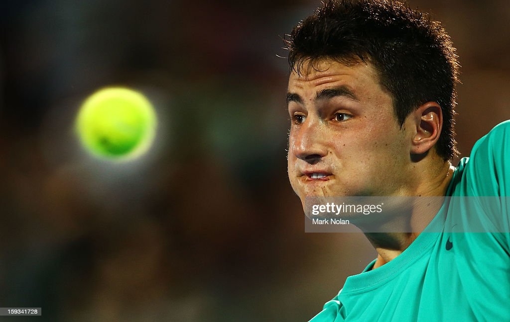 <a gi-track='captionPersonalityLinkClicked' href=/galleries/search?phrase=Bernard+Tomic&family=editorial&specificpeople=650713 ng-click='$event.stopPropagation()'>Bernard Tomic</a> of Australia plays a backhand in the Mens singles final against Kevin Anderson of South Africa during day seven of the Sydney International at Sydney Olympic Park Tennis Centre on January 12, 2013 in Sydney, Australia.