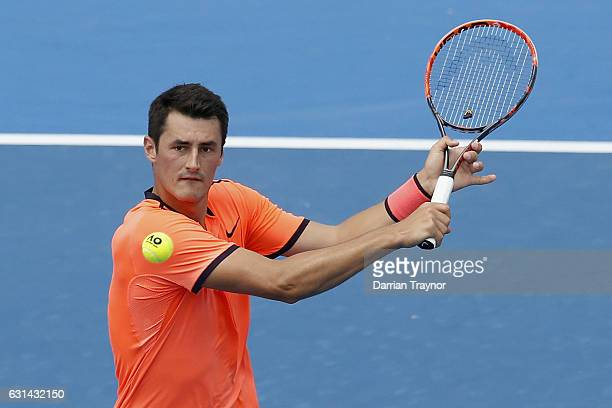 Bernard Tomic of Australia plays a backhand shot in his match against David Goffin of Belgium during day two of the 2017 Priceline Pharmacy Classic...