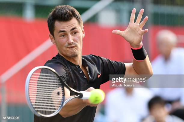 Bernard Tomic of Australia plays a forehand against Diego Schwartzman of Argentina during day three of the Rakuten Open at Ariake Coliseum on October...