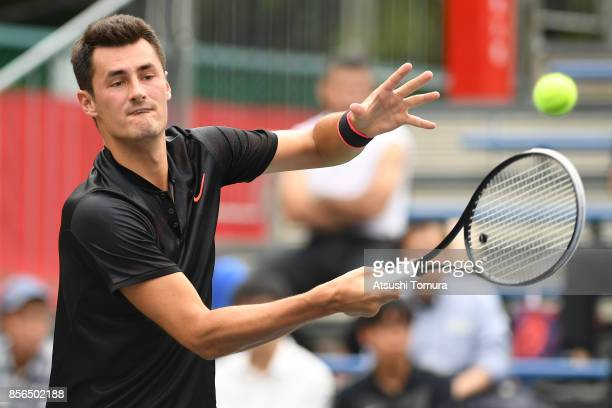 Bernard Tomic of Australia plays a forehand against Joao Sousa of Portugal during day one of the Rakuten Open at Ariake Coliseum on October 2 2017 in...