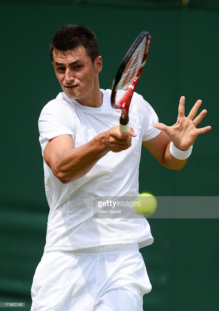 Bernard Tomic of Australia plays a forehand during his Gentlemen's Singles second round match against James Blake of the United States of America on day four of the Wimbledon Lawn Tennis Championships at the All England Lawn Tennis and Croquet Club on June 27, 2013 in London, England.