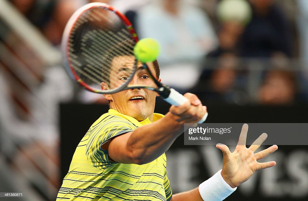 Bernard Tomic of Australia plays a forehand during his match against Blaz Kavcic of Slovenia during day four of the 2014 Sydney International at Sydney Olympic Park Tennis Centre on January 8, 2014 in Sydney, Australia.