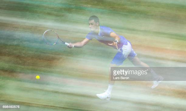 Bernard Tomic of Australia plays a forehand during his match against Tommy Haas of Australia during Day 4 of the Gerry Weber Open 2017 at on June 20...