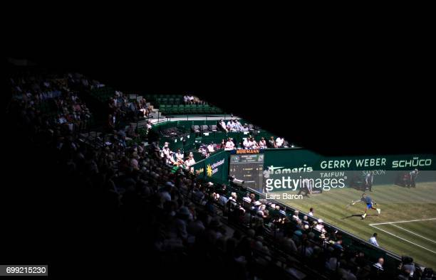 Bernard Tomic of Australia plays a forehand during his match against Richard Gasquet of France during Day 5 of the Gerry Weber Open 2017 at Gerry...