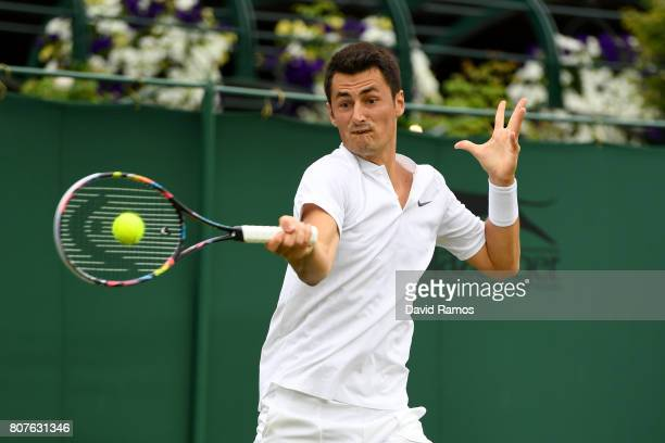 Bernard Tomic of Australia plays a forehand during the Gentlemen's Singles first round match against Mischa Zverev of Germany on day two of the...