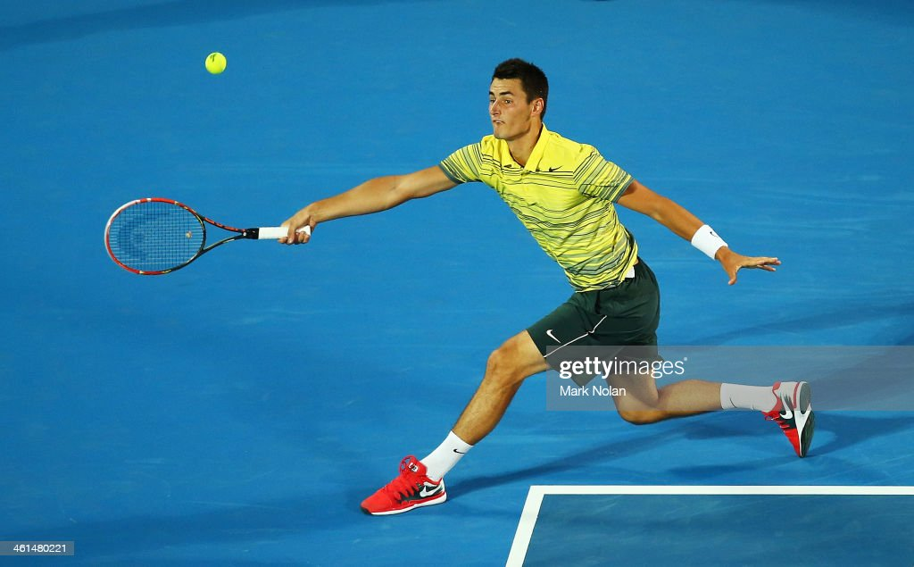 Bernard Tomic of Australia plays a forehand in his match against Alexandr Dolgopolov of the Ukraine during day five of the 2014 Sydney International at Sydney Olympic Park Tennis Centre on January 9, 2014 in Sydney, Australia.