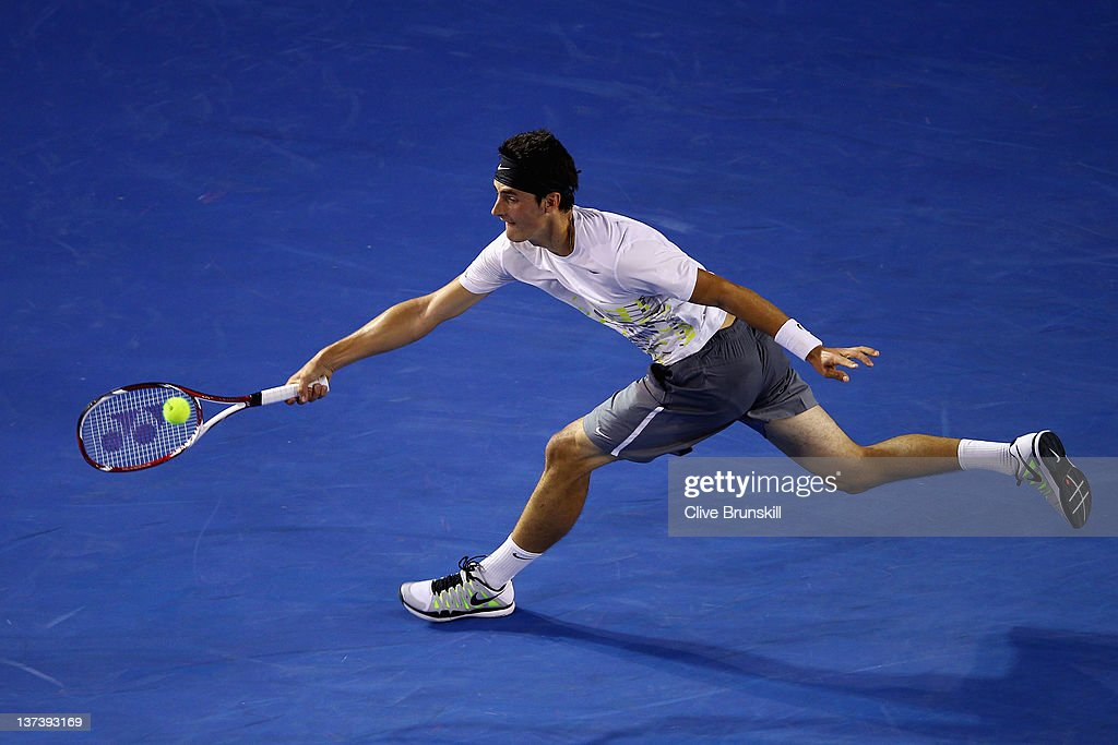 <a gi-track='captionPersonalityLinkClicked' href=/galleries/search?phrase=Bernard+Tomic&family=editorial&specificpeople=650713 ng-click='$event.stopPropagation()'>Bernard Tomic</a> of Australia plays a forehand in his third round match against Alexandr Dolgopolov of the Ukraine during day five of the 2012 Australian Open at Melbourne Park on January 20, 2012 in Melbourne, Australia.