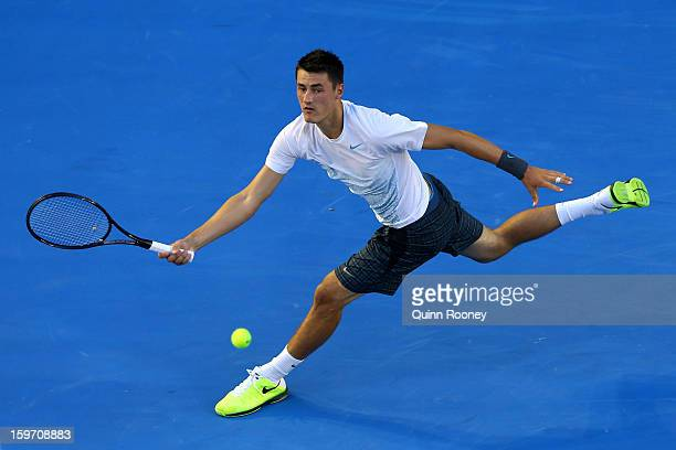 Bernard Tomic of Australia plays a forehand in his third round match against Roger Federer of Switzerland during day six of the 2013 Australian Open...