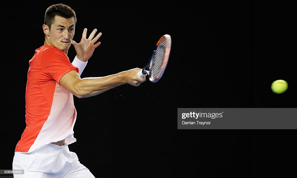Bernard Tomic of Australia plays a forehand in his third round match against John Millman of Australia during day six of the 2016 Australian Open at Melbourne Park on January 23, 2016 in Melbourne, Australia.
