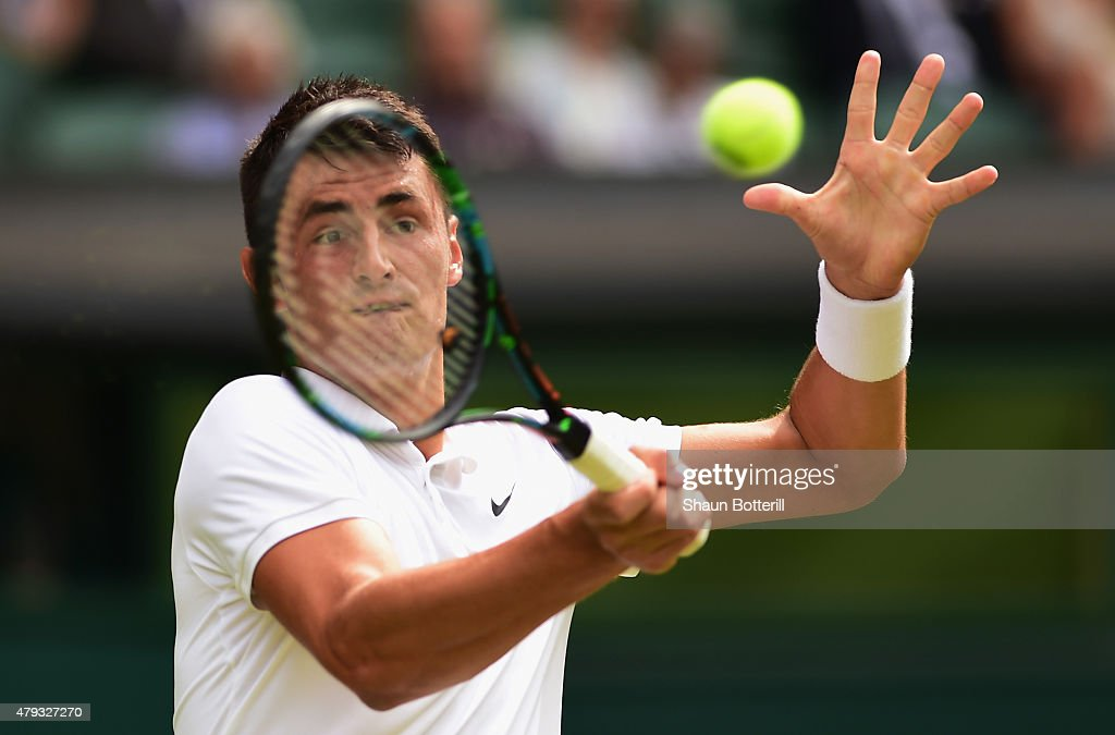 Bernard Tomic of Australia plays a forehand in in his Gentlemen's Singles Third Round match against Novak Djokovic of Serbia during day five of the Wimbledon Lawn Tennis Championships at the All England Lawn Tennis and Croquet Club on July 3, 2015 in London, England.