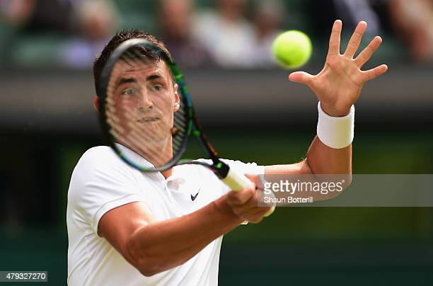 Bernard Tomic of Australia plays a forehand in in his Gentlemen's Singles Third Round match against Novak Djokovic of Serbia during day five of the...
